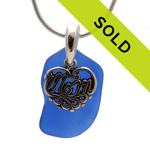 A nice piece of Top Quality Certified Genuine Sea Glass from North Carolina set with a detailed solid sterling Heart charm that lets MOM know you love her.  Sorry this sea glass necklace has been sold!