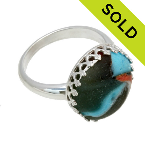 A sea glass marble fragment set in a gallery wire bezel ring.  This is a genuine beach found sea glass marble. Sorry this Sea Glass Ring has been SOLD!