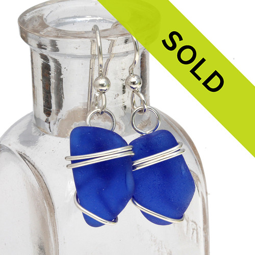 A pair of simple Genuine Blue Sea Glass earrings in solid sterling silver. Sorry this sea glass jewelry selection is no longer available.