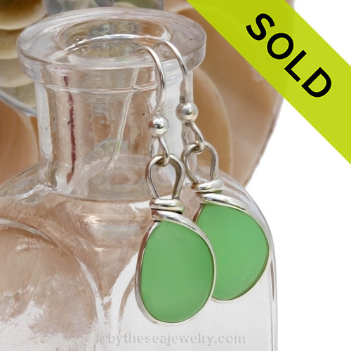 ULTRA RARE UV Jadeite Green Glowing Sea Glass Earrings set in our Original Wire Bezel ©2000 Setting lets all the beauty of these beauties shine! This setting does not alter the sea glass from the way it was found on the beach. Sorry this Sea Glass Jewelry Selection has been SOLD!