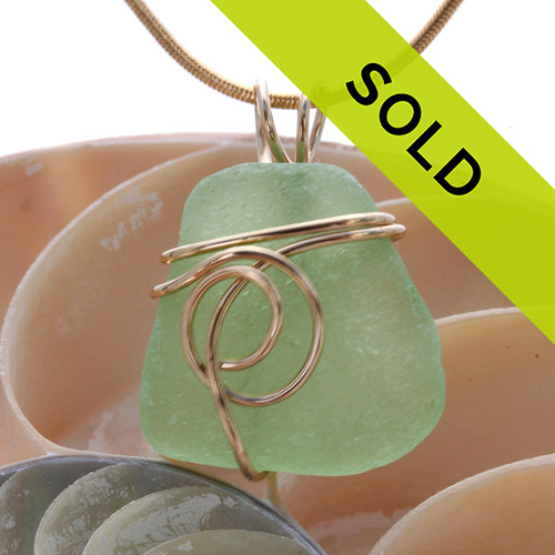 A perfect piece of vivid seafoam green sea glass in one of our signature settings. A great smaller pendant for any necklace. Sorry this sea glass jewelry piece has been sold!