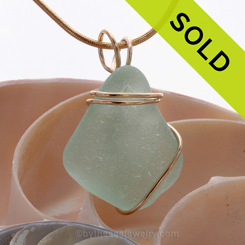 Aqua blue sea glass necklace pendant in simple gold setting. Sorry this Sea Glass Jewelry piece has been sold!