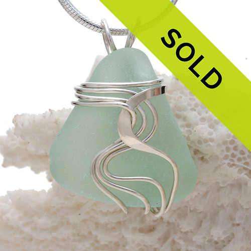 Top quality pale aqua blue sea glass set in our signature WAVES pendant setting. This setting leaves the sea glass totally UNALTERED from the way it was found on the beach! Sorry this sea glass jewelry selection has been sold!