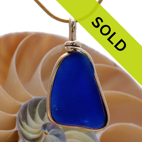 This pendant piece looks to have been the bottom of an old blue jar, maybe Noxzema. Sorry this sea glass jewelry piece is no longer available.