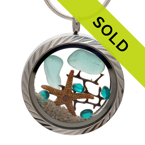 Aqua  Blue genuine beach found sea glass combined with a real starfish, a bit of seafan and crystal gems, a real underwater scene. Your own personal Beach-On-The-Go! Sorry this sea glass jewelry selection has been sold!