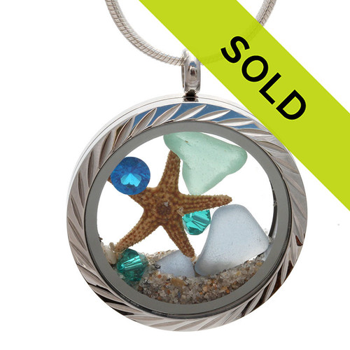 Aqua and Carolina Blue genuine beach found sea glass combined with a real starfish and crystal gems, a real beachy scene. Your own personal Beach-On-The-Go! Sorry this sea glass locket has been sold!