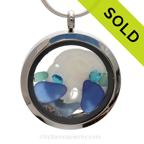 Aqua and  Blue genuine beach found sea glass combined with a real sandollar and crystal gems, a real beachy scene. Sorry this sea glass locket necklace has been sold.