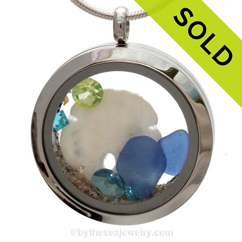 Blue genuine beach found sea glass combined with a real sandollar and crystal gems, a real beachy scene. Sorry this Sea Glass Jewelry selection has been SOLD!