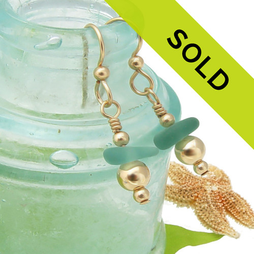 Sorry these aqua green sea glass earrings in gold have sold!