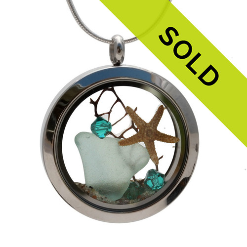 Soft aqua genuine beach found sea glass combined with a real starfish, a bit of seafan and crystal gems, a real underwater scene. Your own personal Beach-On-The-Go! Sorry this sea glass jewelry selection has been sold!