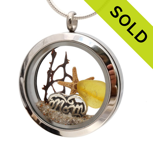 An Ultra Rare piece of genuine golden sea glass  a real starfish, a bit of seafan and a solid sterling MOM charm completes this sea glass locket necklace. SOLD - Sorry This Sea Glass Jewelry Selection Is NO LONGER AVAILABLE!