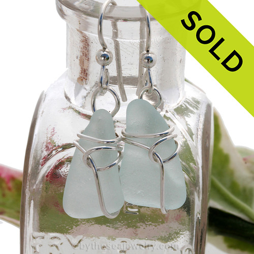 A pair of pale aqua blue sea glass pieces set in a simple sterling deco inspired setting. Sorry this sea glass jewelry selection is no longer available.
