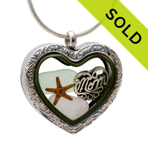A Seafoam Green and a Rare Pale Purple sea glass pieces in combined with a real starfish combined a heart locket in this sea glass locket necklace. SOLD - Sorry this Sea Glass Locket is NO LONGER AVAILABLE!