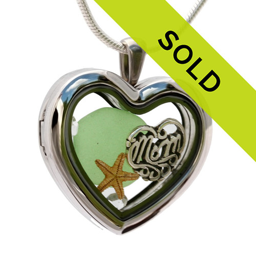 A Green  sea glass piece in combined with a real starfish combined a heart locket in this sea glass locket necklace. Sorry this sea glass jewelry selection has been sold!