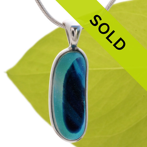 A beautiful bright blue base holds vivid blue , purple and a touch of green in this Seaham Sea Glass Multi set in our timeless, classic Deluxe Wire Bezel© setting in solid sterling silver. Sorry this piece of sea glass jewelry has been sold!