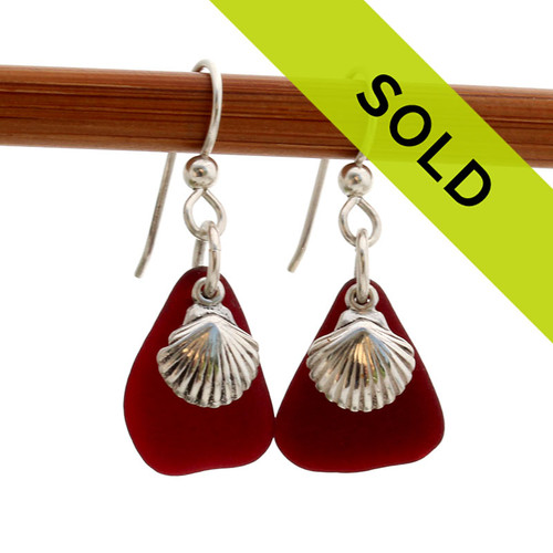 Ruby Red Sea glass earrings. Matching genuine natural sea glass for earrings requires HUNDREDS of pieces of sea glass to make a pair like this. REMEMBER - We do not shape our glass, this is just the way it was found on the beach.  Sorry this rare red sea glass earring pair has SOLD!