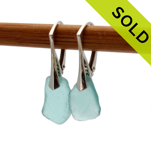 Simple beach found aqua sea glass pieces set on top quality solid sterling silver leverbacks. SOLD - Sorry these Sea Glass Earrings are no longer available.