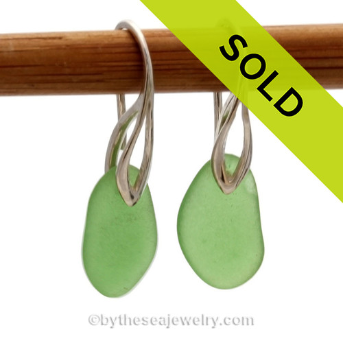 Simple and elegant beach found green sea glass pieces on solid sterling silver deco hooks. Sorry these sea glass earrings have been sold!