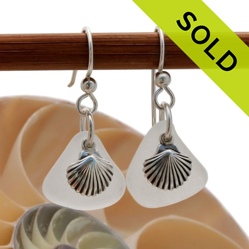 Airy and light pure white sea glass earrings in sterling with sterling sea shell charms! Sorry this Sea Glass Jewelry selection has been SOLD!