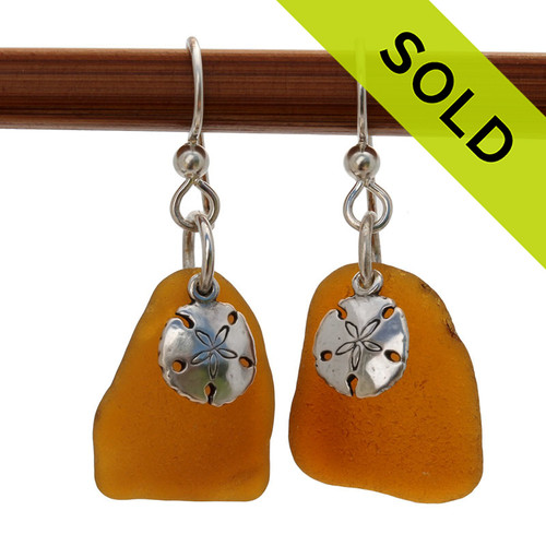 These are 2 larger thin pieces of perfect amber Certified Genuine Sea Glass in a simple sterling setting with Solid Sterling Silver sandollar charms.  SOLD - Sorry these Sea Glass Earrings are NO LONGER AVAILABLE!