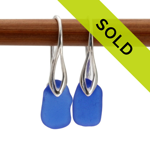 An elegant petite pair of natural beach found Sea Glass Earrings in a Cobalt Blue on Sterling Silver Deco Hooks. Sorry this sea glass jewelry selection has been sold!