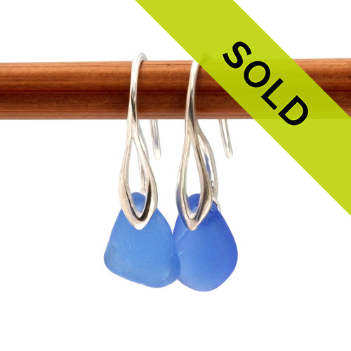 An elegant petite pair of natural beach found Sea Glass Earrings in a Bright Vivid Blue on Sterling Silver Deco Hooks. Sorry this sea glass jewelry selection is no longer available.