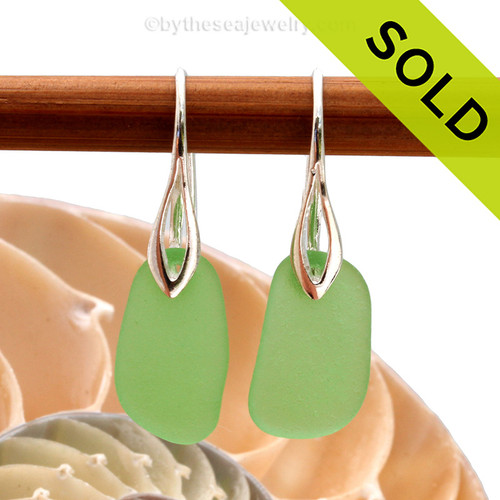 Simple and elegant beach found green sea glass pieces on solid sterling silver deco hooks. Sorry this sea glass jewelry selection has been sold!