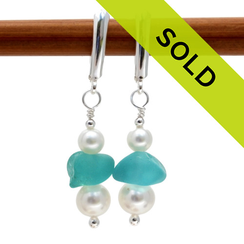 Beautiful aqua sea glass is combined with fresh water pearls on solid sterling leverback earrings.. Elegant and simple sea glass earrings. Sorry this sea glass jewelry selection is no longer available.
