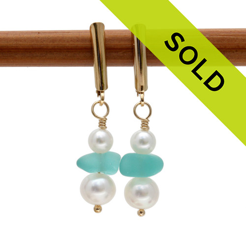 Beautiful aqua sea glass is combined with fresh water pearls on 14K Goldfilled leverback earrings. Elegant and simple sea glass earrings. Sorry this sea glass jewelry selection is no longer available.