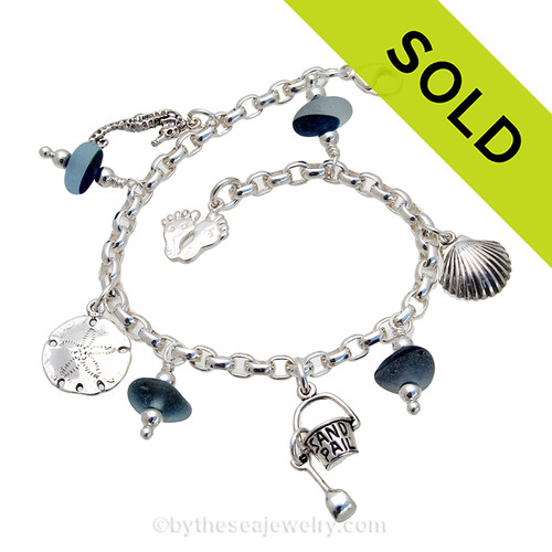 4 pieces of mixed Teal Blue English Sea Glass combined with solid sterling beach inspired charms in a totally solid sterling silver bracelet.  All solid sterling charms that will remind you of your time at the beach Sorry this Sea Glass Bracelet has been SOLD!