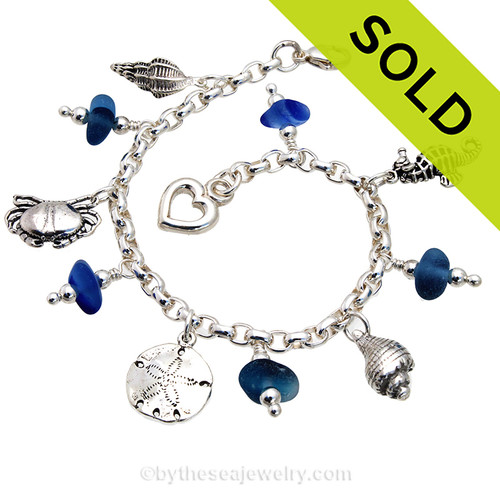 5 pieces of mixed Victorian English Sea Glass combined with solid sterling beach inspired charms in a totally solid sterling silver bracelet.  All solid sterling charms that will remind you of your time at the beach! Sorry this Sea Glass Bracelet has been SOLD!