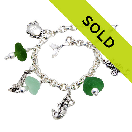 4 pieces of top quality Victorian English Sea Glass combined with solid sterling beach inspired charms in a totally solid sterling silver bracelet.   Sorry this sea glass jewelry selection has been sold!