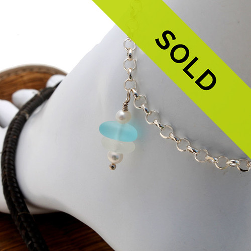A simple white and aqua sea glass anklet with AAA Grade pearls for your beach trips this summer. Sorry this sea glass jewelry item has been sold!