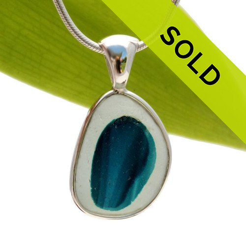 This ultra rare Seaham sea glass multi bright blue and teal pendant is set in our Deluxe Wire Bezel© pendant setting. Sorry this sea glass jewelry piece is no longer available.