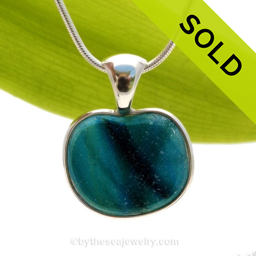 This ultra ULTRA RARE rare Seaham sea glass heart multi bright blue and teal pendant is set in our Deluxe Wire Bezel© pendant setting. Sorry this sea glass jewelry selection has been sold!