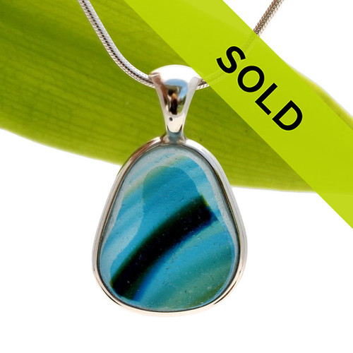 This ultra ULTRA RARE 4+ Color Multi Seaham sea glass pendant is set in our Deluxe Wire Bezel© pendant setting. Sorry this one of a kind piece is no longer available!
