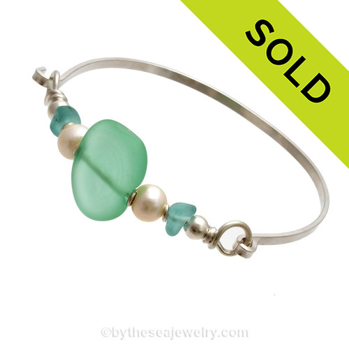 Two pieces of beach found sea glass in aqua on this solid sterling silver thin sea glass bangle bracelet. Sorry this sea glass jewelry piece has been sold!