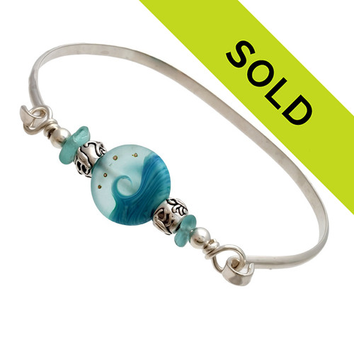 Two pieces of beach found sea glass in vivid tropical aqua on this solid sterling silver half round sea glass bangle bracelet.  Sorry this sea glass jewelry item has been sold!