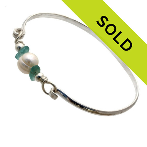 Two aqua sea glass pieces from Hawaii are combined with a LARGE genuine fresh water pearl on a solid sterling bangle bracelet. Sorry this Sea Glass Jewelry piece has been SOLD!