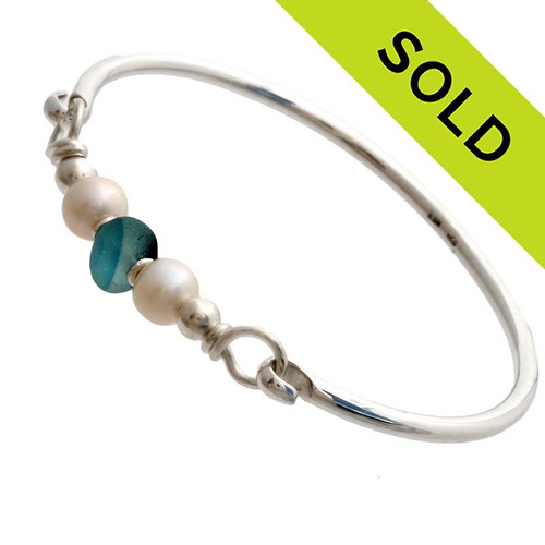 Vivid mixed aqua beach found sea glass combined with real cultured pearls on this solid sterling silver half round sea glass bangle bracelet.  SOLD - Sorry this Sea Glass Jewelry selection is NO LONGER AVAILABLE.