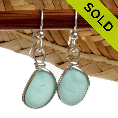 Perfect pieces of naturally collected VIVID aqua blue sea glass in our ORIGINAL Wire Bezel© setting in Silver. Sorry these Sea Glass Earrings have been SOLD!