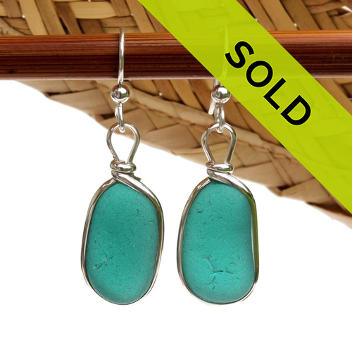 A P-E-R-F-E-C-T match in  Sea Glass Earrings in a vivid Vivid Teal set in our Original Wire Bezel© setting in silver. Sorry these sea glass earrings have already been sold!