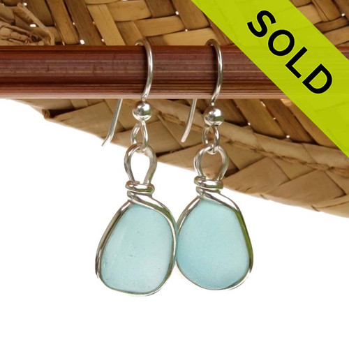 Perfect pieces of naturally collected Carolina Blue sea glass in our ORIGINAL Wire Bezel© setting in Silver. Sorry these Sea Glass Earrings have been SOLD!