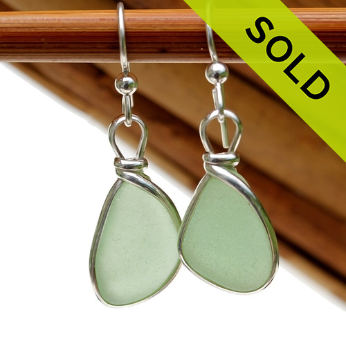 Genuine beach found Bright Seafoam Green Sea Glass Earrings in a Solid Sterling Silver Original Wire Bezel© setting.