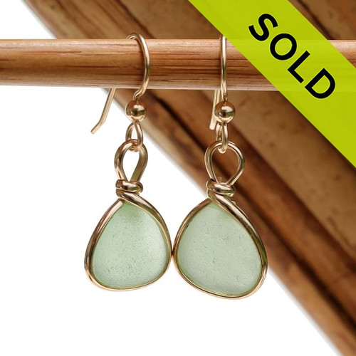 Genuine beach found bright green sea glass earrings in a 14K Rolled Gold Original Wire Bezel setting. Sorry this Sea Glass Jewelry selection has been SOLD!