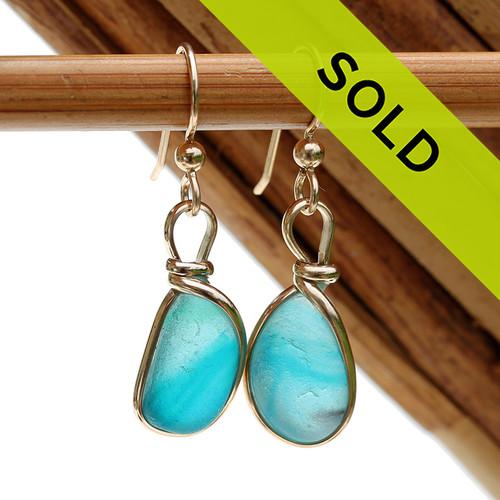 An ultra rare match of mixed electric aqua  English sea glass piece from Seaham England in our Original Gold Wire Bezel© sea glass earring setting. Sorry this Ultra Rare Sea Glass Jewelry selection has been sold!