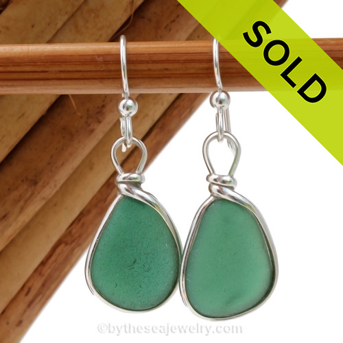 Perfect pieces of all natural genuine beach found sea glass in an unusual Deep Aqua Green in our original Wire Bezel© Earring Setting. Sorry this Sea Glass Jewelry item has been SOLD!