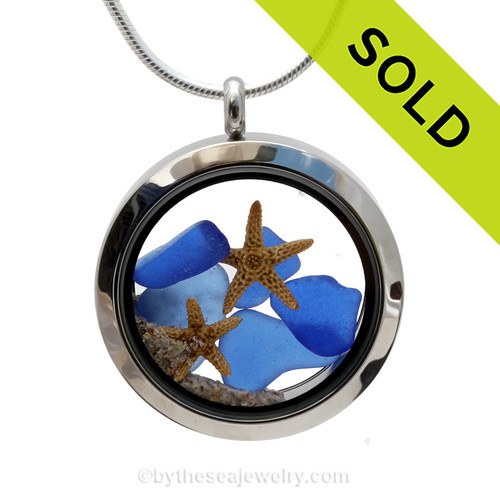A beautiful pieces of natural blue sea glass combined in a stainless steel locket necklace with a two real starfish and beach sand. Sorry this sea glass locket has been SOLD!