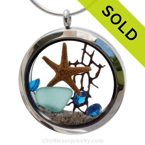 Genuine vivid aqua sea glass piece from Hawaii combined with a real starfish and bit of seafan and a real beach sand for a tropical underwater scene. Sorry this sea glass jewelry piece has been sold!