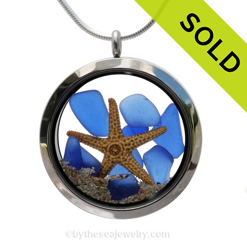 Genuine blue sea glass pieces combined with a starfish in this JUMBO 35MM stainless steel locket. Sorry this Sea Glass Jewelry piece has been SOLD!